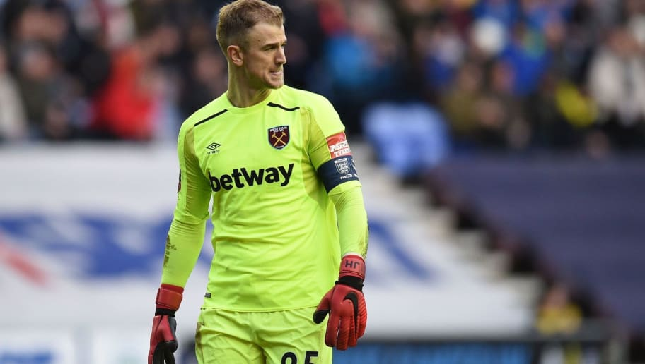 West Ham United's English goalkeeper Joe Hart gestures during the English FA Cup fourth round football match between Wigan Athletic and West Ham United at the DW Stadium in Wigan, northwest England, on January 27, 2018. / AFP PHOTO / Oli SCARFF / RESTRICTED TO EDITORIAL USE. No use with unauthorized audio, video, data, fixture lists, club/league logos or 'live' services. Online in-match use limited to 75 images, no video emulation. No use in betting, games or single club/league/player publications.  /         (Photo credit should read OLI SCARFF/AFP/Getty Images)