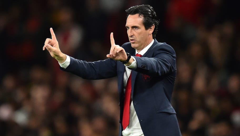 Arsenal's Spanish head coach Unai Emery shouts instructions to his players from the touchline during the English League Cup third round football match between Arsenal and Brentford at the Emirates Stadium in London on September 26, 2018. (Photo by Glyn KIRK / AFP) / RESTRICTED TO EDITORIAL USE. No use with unauthorized audio, video, data, fixture lists, club/league logos or 'live' services. Online in-match use limited to 120 images. An additional 40 images may be used in extra time. No video emulation. Social media in-match use limited to 120 images. An additional 40 images may be used in extra time. No use in betting publications, games or single club/league/player publications. /         (Photo credit should read GLYN KIRK/AFP/Getty Images)