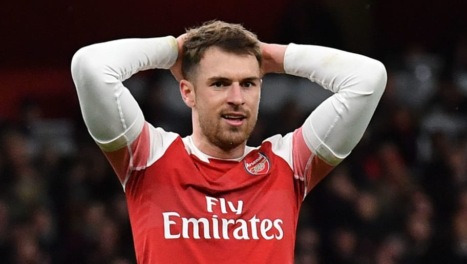 Arsenal's Welsh midfielder Aaron Ramsey reacts during the English League Cup quarter-final football match between Arsenal and Tottenham Hotspur at the Emirates Stadium in London on December 19, 2018. (Photo by Ben STANSALL / AFP) / RESTRICTED TO EDITORIAL USE. No use with unauthorized audio, video, data, fixture lists, club/league logos or 'live' services. Online in-match use limited to 120 images. An additional 40 images may be used in extra time. No video emulation. Social media in-match use limited to 120 images. An additional 40 images may be used in extra time. No use in betting publications, games or single club/league/player publications. /         (Photo credit should read BEN STANSALL/AFP/Getty Images)