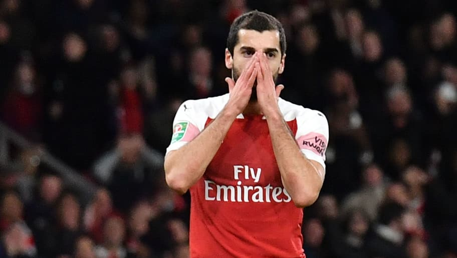 Arsenal's Armenian midfielder Henrikh Mkhitaryan reacts during the English League Cup quarter-final football match between Arsenal and Tottenham Hotspur at the Emirates Stadium in London on December 19, 2018. (Photo by Ben STANSALL / AFP) / RESTRICTED TO EDITORIAL USE. No use with unauthorized audio, video, data, fixture lists, club/league logos or 'live' services. Online in-match use limited to 120 images. An additional 40 images may be used in extra time. No video emulation. Social media in-match use limited to 120 images. An additional 40 images may be used in extra time. No use in betting publications, games or single club/league/player publications. /         (Photo credit should read BEN STANSALL/AFP/Getty Images)