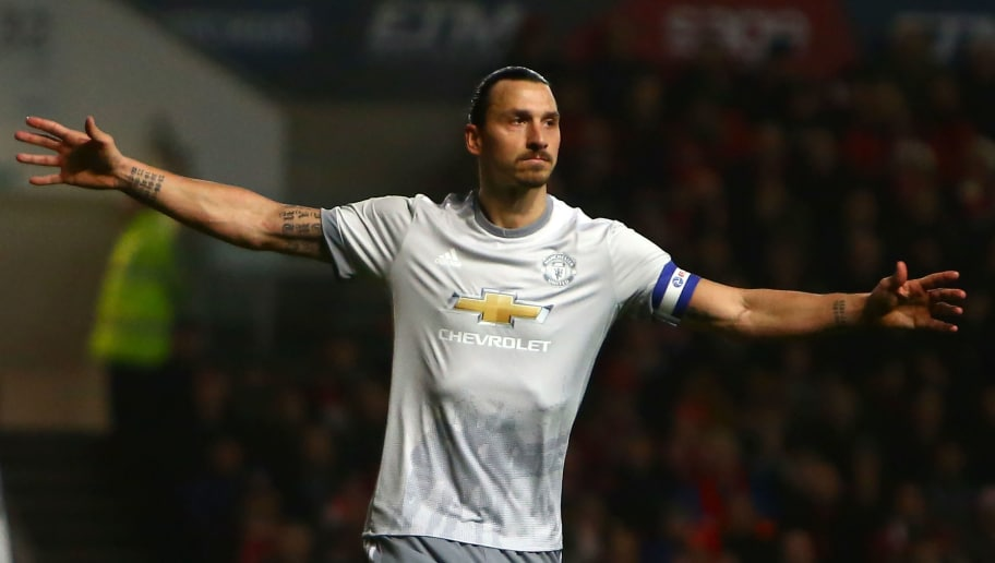 Manchester United's Swedish striker Zlatan Ibrahimovic celebrates scoring the team's first goal during the English League Cup quarter-final football match between Bristol City and Manchester United at Ashton Gate Stadium in Bristol, southwest England on December 20, 2017. / AFP PHOTO / Geoff CADDICK / RESTRICTED TO EDITORIAL USE. No use with unauthorized audio, video, data, fixture lists, club/league logos or 'live' services. Online in-match use limited to 75 images, no video emulation. No use in betting, games or single club/league/player publications.  /         (Photo credit should read GEOFF CADDICK/AFP/Getty Images)