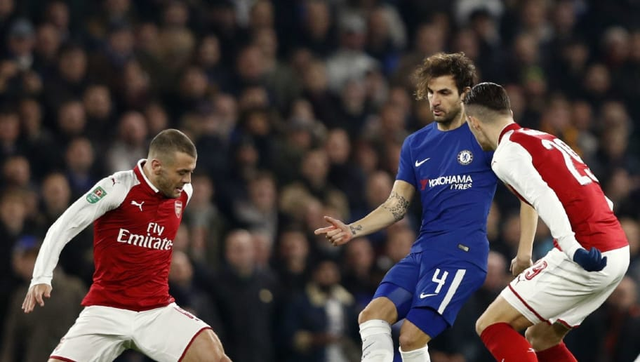 Arsenal's English midfielder Jack Wilshere (L) vies with Chelsea's Spanish midfielder Cesc Fabregas (C) during the English League Cup semi-final first leg football match between Chelsea and Arsenal at Stamford Bridge in London on January 10, 2018. / AFP PHOTO / Adrian DENNIS / RESTRICTED TO EDITORIAL USE. No use with unauthorized audio, video, data, fixture lists, club/league logos or 'live' services. Online in-match use limited to 75 images, no video emulation. No use in betting, games or single club/league/player publications.  /         (Photo credit should read ADRIAN DENNIS/AFP/Getty Images)