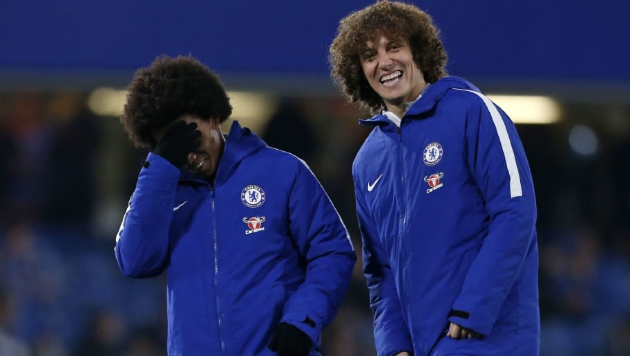 Chelsea's Brazilian midfielder Willian (L) shares a joke with Chelsea's Brazilian defender David Luiz ahead of the English League Cup semi-final first leg football match between Chelsea and Arsenal at Stamford Bridge in London on January 10, 2018. / AFP PHOTO / Ian KINGTON / RESTRICTED TO EDITORIAL USE. No use with unauthorized audio, video, data, fixture lists, club/league logos or 'live' services. Online in-match use limited to 75 images, no video emulation. No use in betting, games or single club/league/player publications.  /         (Photo credit should read IAN KINGTON/AFP/Getty Images)