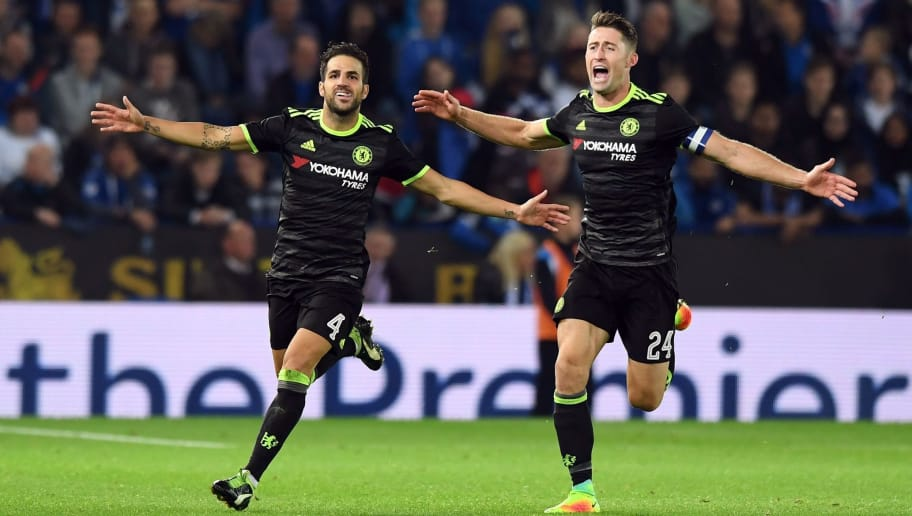 Chelsea's Spanish midfielder Cesc Fabregas (L) celebrates scoring their fourth goal with teammate Gary Cahill (R) during extra-time in the English League Cup third round football match between Leicester City and Chelsea at King Power Stadium in Leicester, central England on September 20, 2016. / AFP / ANTHONY DEVLIN / RESTRICTED TO EDITORIAL USE. No use with unauthorized audio, video, data, fixture lists, club/league logos or 'live' services. Online in-match use limited to 75 images, no video emulation. No use in betting, games or single club/league/player publications.  /         (Photo credit should read ANTHONY DEVLIN/AFP/Getty Images)