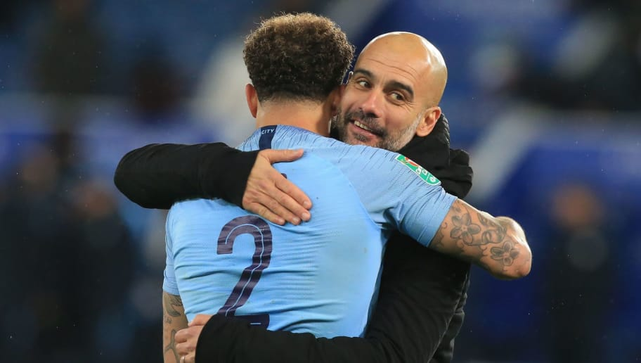 Manchester City's English defender Kyle Walker (L) celebrates with Manchester City's Spanish manager Pep Guardiola (R) on the pitch after the English League Cup quarter-final football match between Leicester City and Manchester City at King Power Stadium in Leicester, central England on December 18, 2018. - Manchester City won 3-1 on penalties after the game finished 1-1. (Photo by Lindsey PARNABY / AFP) / RESTRICTED TO EDITORIAL USE. No use with unauthorized audio, video, data, fixture lists, club/league logos or 'live' services. Online in-match use limited to 120 images. An additional 40 images may be used in extra time. No video emulation. Social media in-match use limited to 120 images. An additional 40 images may be used in extra time. No use in betting publications, games or single club/league/player publications. /         (Photo credit should read LINDSEY PARNABY/AFP/Getty Images)