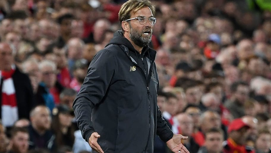Liverpool's German manager Jurgen Klopp reacts during the English League Cup third round football match between Liverpool and Chelsea at Anfield in Liverpool, north west England on September 26, 2018. (Photo by Paul ELLIS / AFP) / RESTRICTED TO EDITORIAL USE. No use with unauthorized audio, video, data, fixture lists, club/league logos or 'live' services. Online in-match use limited to 120 images. An additional 40 images may be used in extra time. No video emulation. Social media in-match use limited to 120 images. An additional 40 images may be used in extra time. No use in betting publications, games or single club/league/player publications. /         (Photo credit should read PAUL ELLIS/AFP/Getty Images)