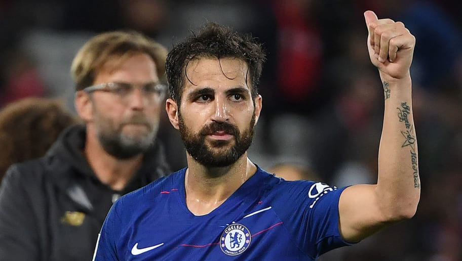 Chelsea's Spanish midfielder Cesc Fabregas applauds the fans following the English League Cup third round football match between Liverpool and Chelsea at Anfield in Liverpool, north west England on September 26, 2018. (Photo by Paul ELLIS / AFP) / RESTRICTED TO EDITORIAL USE. No use with unauthorized audio, video, data, fixture lists, club/league logos or 'live' services. Online in-match use limited to 120 images. An additional 40 images may be used in extra time. No video emulation. Social media in-match use limited to 120 images. An additional 40 images may be used in extra time. No use in betting publications, games or single club/league/player publications. /         (Photo credit should read PAUL ELLIS/AFP/Getty Images)