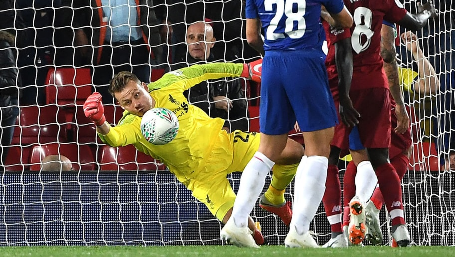 Liverpool's Belgian goalkeeper Simon Mignolet (L) fails to save a shot from Chelsea's Brazilian defender Emerson Palmieri during the English League Cup third round football match between Liverpool and Chelsea at Anfield in Liverpool, north west England on September 26, 2018. (Photo by Paul ELLIS / AFP) / RESTRICTED TO EDITORIAL USE. No use with unauthorized audio, video, data, fixture lists, club/league logos or 'live' services. Online in-match use limited to 120 images. An additional 40 images may be used in extra time. No video emulation. Social media in-match use limited to 120 images. An additional 40 images may be used in extra time. No use in betting publications, games or single club/league/player publications. /         (Photo credit should read PAUL ELLIS/AFP/Getty Images)
