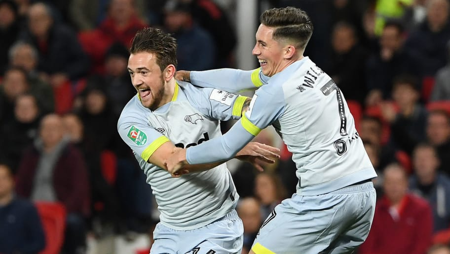 Derby's English striker Jack Marriott (C) celebrates scoring his team's second goal with Derby's Welsh midfielder Harry Wilson during the English League Cup third round football match between Manchester United and Derby County at Old Trafford in Manchester, north west England, on September 25, 2018. (Photo by Paul ELLIS / AFP) / RESTRICTED TO EDITORIAL USE. No use with unauthorized audio, video, data, fixture lists, club/league logos or 'live' services. Online in-match use limited to 120 images. An additional 40 images may be used in extra time. No video emulation. Social media in-match use limited to 120 images. An additional 40 images may be used in extra time. No use in betting publications, games or single club/league/player publications. /         (Photo credit should read PAUL ELLIS/AFP/Getty Images)