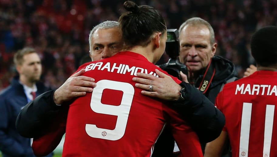 Manchester United's Swedish striker Zlatan Ibrahimovic embraces Manchester United's Portuguese manager Jose Mourinho as players celebrate on the pitch after their victory in the English League Cup final football match between Manchester United and Southampton at Wembley stadium in north London on February 26, 2017. Zlatan Ibrahimovic sealed the first major silverware of Jose Mourinho's Manchester United reign and broke Southampton's hearts as the Swedish star's late goal clinched a dramatic 3-2 victory in Sunday's League Cup final. / AFP / Ian KINGTON / RESTRICTED TO EDITORIAL USE. No use with unauthorized audio, video, data, fixture lists, club/league logos or 'live' services. Online in-match use limited to 75 images, no video emulation. No use in betting, games or single club/league/player publications.  /         (Photo credit should read IAN KINGTON/AFP/Getty Images)