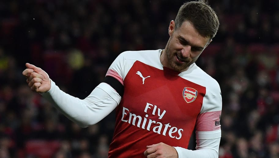Arsenal's Welsh midfielder Aaron Ramsey reacts after failing to score during the English League Cup football match between West Ham United and Tottenham Hotspur at The London Stadium, in east London on October 31, 2018. (Photo by Ben STANSALL / AFP) / RESTRICTED TO EDITORIAL USE. No use with unauthorized audio, video, data, fixture lists, club/league logos or 'live' services. Online in-match use limited to 120 images. An additional 40 images may be used in extra time. No video emulation. Social media in-match use limited to 120 images. An additional 40 images may be used in extra time. No use in betting publications, games or single club/league/player publications. /         (Photo credit should read BEN STANSALL/AFP/Getty Images)
