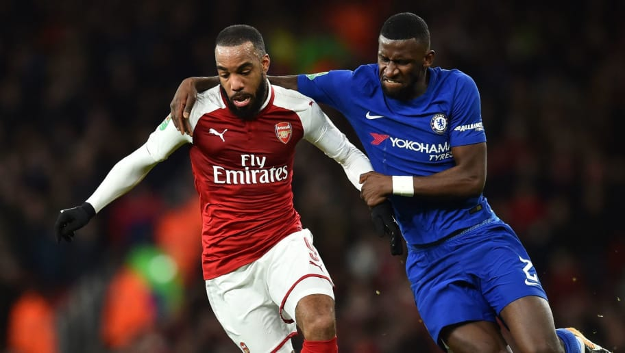 Chelsea's German defender Antonio Rudiger (R) vies with Arsenal's French striker Alexandre Lacazette during the League Cup semi-final football match between Arsenal and Chelsea at the Emirates Stadium in London on January 24, 2018.  / AFP PHOTO / Glyn KIRK / RESTRICTED TO EDITORIAL USE. No use with unauthorized audio, video, data, fixture lists, club/league logos or 'live' services. Online in-match use limited to 75 images, no video emulation. No use in betting, games or single club/league/player publications.  /         (Photo credit should read GLYN KIRK/AFP/Getty Images)