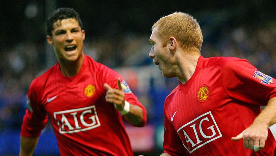 Manchester United footballer Paul Scholes (R) celebrates his goal with teammate Cristiano Ronaldo (L) as they play against Portsmouth at Fratton Park in Portsmouth, in southern England, 15 August 2007. AFP PHOTO/CARL DE SOUZA   Mobile and website use of domestic English football pictures are subject to obtaining a Photographic End User Licence from Football DataCo Ltd Tel : +44 (0) 207 864 9121 or e-mail accreditations@football-dataco.com - applies to Premier and Football League matches. (Photo by Carl DE SOUZA / AFP)        (Photo credit should read CARL DE SOUZA/AFP/Getty Images)