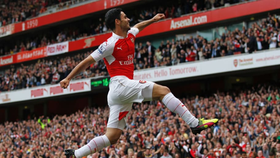 Arsenal's Spanish midfielder Mikel Arteta celebrates scoring his team's fourth goal during the English Premier League football match between Arsenal and Aston Villa at the Emirates Stadium in London on May 15, 2016.  / AFP / IAN KINGTON / RESTRICTED TO EDITORIAL USE. No use with unauthorized audio, video, data, fixture lists, club/league logos or 'live' services. Online in-match use limited to 75 images, no video emulation. No use in betting, games or single club/league/player publications.  /         (Photo credit should read IAN KINGTON/AFP/Getty Images)