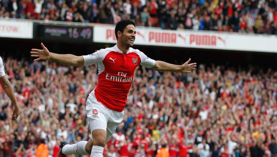 Arsenal's Spanish midfielder Mikel Arteta (R) celebrates scoring his team's fourth goal with Arsenal's French striker Olivier Giroud during the English Premier League football match between Arsenal and Aston Villa at the Emirates Stadium in London on May 15, 2016.  / AFP / Ian Kington / RESTRICTED TO EDITORIAL USE. No use with unauthorized audio, video, data, fixture lists, club/league logos or 'live' services. Online in-match use limited to 75 images, no video emulation. No use in betting, games or single club/league/player publications.  /         (Photo credit should read IAN KINGTON/AFP/Getty Images)