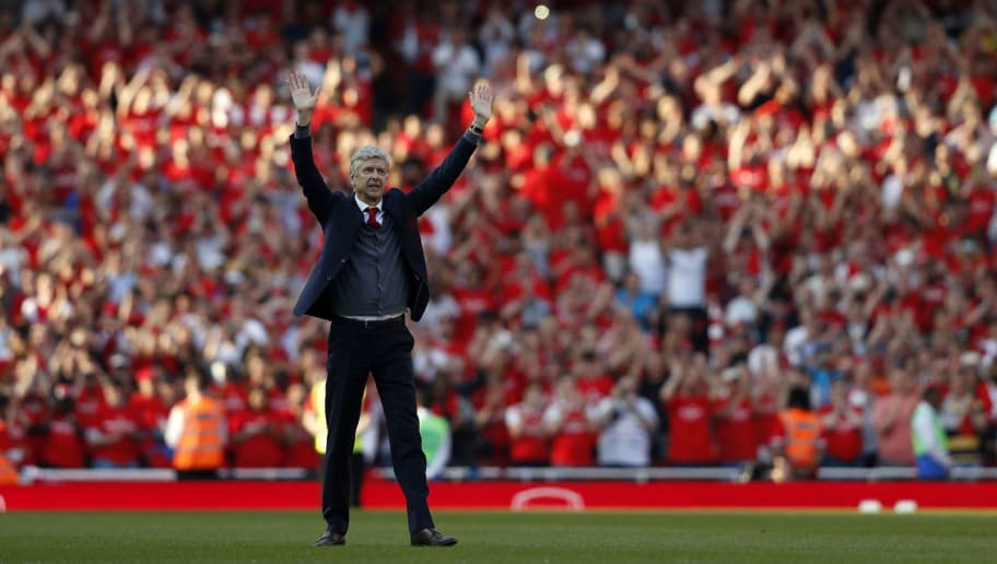 Arsenal's French manager Arsene Wenger waves to supporters at a ceremony on the pitch after the English Premier League football match between Arsenal and Burnley at the Emirates Stadium in London on May 6, 2018. - Arsene Wenger bids farewell to a stadium he helped to build in more ways than one when he leads Arsenal at the Emirates for the final time at home to Burnley on Sunday. Wenger's final season after 22 years in charge is destined to end in disappointment after Thursday's Europa League semi-final exit. (Photo by Adrian DENNIS / AFP) / RESTRICTED TO EDITORIAL USE. No use with unauthorized audio, video, data, fixture lists, club/league logos or 'live' services. Online in-match use limited to 75 images, no video emulation. No use in betting, games or single club/league/player publications. /         (Photo credit should read ADRIAN DENNIS/AFP/Getty Images)