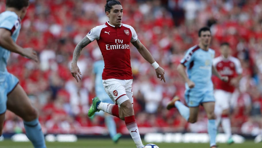 Arsenal's Spanish defender Hector Bellerin runs with the ball during the English Premier League football match between Arsenal and Burnley at the Emirates Stadium in London on May 6, 2018. (Photo by Adrian DENNIS / AFP) / RESTRICTED TO EDITORIAL USE. No use with unauthorized audio, video, data, fixture lists, club/league logos or 'live' services. Online in-match use limited to 75 images, no video emulation. No use in betting, games or single club/league/player publications. /         (Photo credit should read ADRIAN DENNIS/AFP/Getty Images)