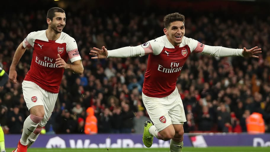 Arsenal's Uruguayan midfielder Lucas Torreira (R) celebrates after scoring the opening goal of the English Premier League football match between Arsenal and Huddersfield Town at the Emirates Stadium in London on December 8, 2018. (Photo by Daniel LEAL-OLIVAS / AFP) / RESTRICTED TO EDITORIAL USE. No use with unauthorized audio, video, data, fixture lists, club/league logos or 'live' services. Online in-match use limited to 120 images. An additional 40 images may be used in extra time. No video emulation. Social media in-match use limited to 120 images. An additional 40 images may be used in extra time. No use in betting publications, games or single club/league/player publications. /         (Photo credit should read DANIEL LEAL-OLIVAS/AFP/Getty Images)