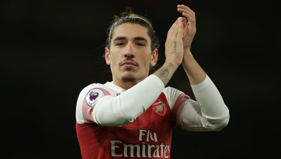 Arsenal's Spanish defender Hector Bellerin applauds supporters on the pitch after the English Premier League football match between Arsenal and Huddersfield Town at the Emirates Stadium in London on December 8, 2018. - Arsenal won the game 1-0. (Photo by Daniel LEAL-OLIVAS / AFP) / RESTRICTED TO EDITORIAL USE. No use with unauthorized audio, video, data, fixture lists, club/league logos or 'live' services. Online in-match use limited to 120 images. An additional 40 images may be used in extra time. No video emulation. Social media in-match use limited to 120 images. An additional 40 images may be used in extra time. No use in betting publications, games or single club/league/player publications. /         (Photo credit should read DANIEL LEAL-OLIVAS/AFP/Getty Images)