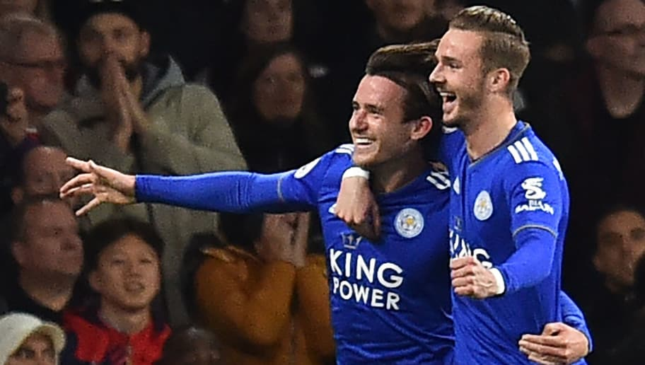 Leicester City's English defender Ben Chilwell (L) celebrates with Leicester City's English midfielder James Maddison after his cross is deflected into the Arsenal goal by Arsenal's Spanish defender Hector Bellerin (not pictured) for their first goal during the English Premier League football match between Arsenal and Leicester City at the Emirates Stadium in London on October 22, 2018. (Photo by Glyn KIRK / IKIMAGES / AFP) / RESTRICTED TO EDITORIAL USE. No use with unauthorized audio, video, data, fixture lists, club/league logos or 'live' services. Online in-match use limited to 45 images, no video emulation. No use in betting, games or single club/league/player publications.        (Photo credit should read GLYN KIRK/AFP/Getty Images)