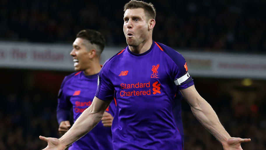 Liverpool's English midfielder James Milner celebrates after scoring the opening goal of the English Premier League football match between Arsenal and Liverpool at the Emirates Stadium in London on November 3, 2018. (Photo by Ian KINGTON / IKIMAGES / AFP) / RESTRICTED TO EDITORIAL USE. No use with unauthorized audio, video, data, fixture lists, club/league logos or 'live' services. Online in-match use limited to 45 images, no video emulation. No use in betting, games or single club/league/player publications.        (Photo credit should read IAN KINGTON/AFP/Getty Images)