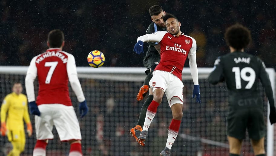 Manchester City's Argentinian defender Nicolas Otamendi (C) vies with Arsenal's Gabonese striker Pierre-Emerick Aubameyang (centre right) during the English Premier League football match between Arsenal and Manchester City at the Emirates Stadium in London on March 1, 2018.  / AFP PHOTO / IKIMAGES / Ian KINGTON / RESTRICTED TO EDITORIAL USE. No use with unauthorized audio, video, data, fixture lists, club/league logos or 'live' services. Online in-match use limited to 45 images, no video emulation. No use in betting, games or single club/league/player publications.  /         (Photo credit should read IAN KINGTON/AFP/Getty Images)