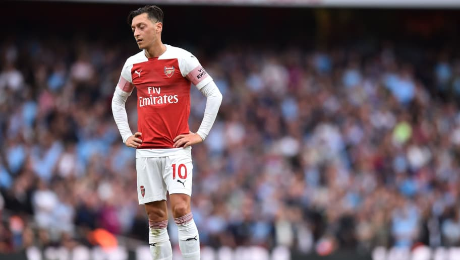 Arsenal's German midfielder Mesut Ozil reacts during the English Premier League football match between Arsenal and Manchester City at the Emirates Stadium in London on August 12, 2018. (Photo by Glyn KIRK / AFP) / RESTRICTED TO EDITORIAL USE. No use with unauthorized audio, video, data, fixture lists, club/league logos or 'live' services. Online in-match use limited to 120 images. An additional 40 images may be used in extra time. No video emulation. Social media in-match use limited to 120 images. An additional 40 images may be used in extra time. No use in betting publications, games or single club/league/player publications. /         (Photo credit should read GLYN KIRK/AFP/Getty Images)