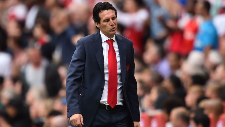 Arsenal's Spanish head coach Unai Emery gestures on the touchline during the English Premier League football match between Arsenal and Manchester City at the Emirates Stadium in London on August 12, 2018. (Photo by Glyn KIRK / AFP) / RESTRICTED TO EDITORIAL USE. No use with unauthorized audio, video, data, fixture lists, club/league logos or 'live' services. Online in-match use limited to 120 images. An additional 40 images may be used in extra time. No video emulation. Social media in-match use limited to 120 images. An additional 40 images may be used in extra time. No use in betting publications, games or single club/league/player publications. /         (Photo credit should read GLYN KIRK/AFP/Getty Images)