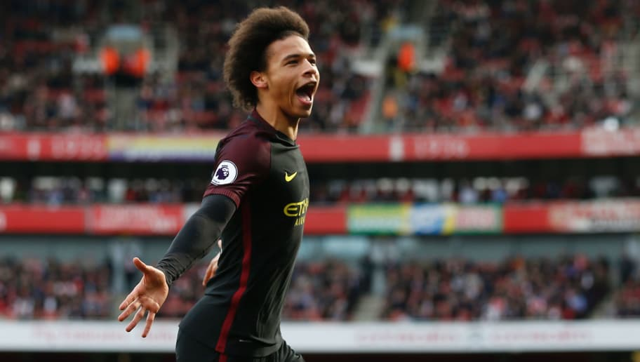Manchester City's German midfielder Leroy Sane celebrates after scoring the opening goal of the English Premier League football match between Arsenal and Manchester City at The Emirates in London, on April 2, 2017. / AFP PHOTO / IKIMAGES / Ian KINGTON / RESTRICTED TO EDITORIAL USE. No use with unauthorized audio, video, data, fixture lists, club/league logos or 'live' services. Online in-match use limited to 45 images, no video emulation. No use in betting, games or single club/league/player publications.        (Photo credit should read IAN KINGTON/AFP/Getty Images)