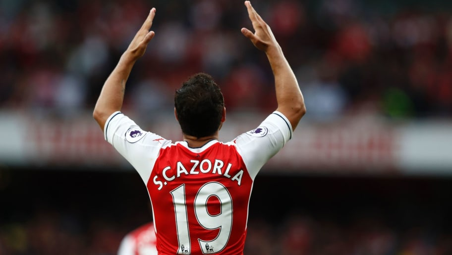 Arsenal's Spanish midfielder Santi Cazorla gestures during the English Premier League football match between Arsenal and Southampton at the Emirates Stadium in London on September 10, 2016.  Arsenal won the game 2-1. / AFP / Adrian DENNIS / RESTRICTED TO EDITORIAL USE. No use with unauthorized audio, video, data, fixture lists, club/league logos or 'live' services. Online in-match use limited to 75 images, no video emulation. No use in betting, games or single club/league/player publications.  /         (Photo credit should read ADRIAN DENNIS/AFP/Getty Images)