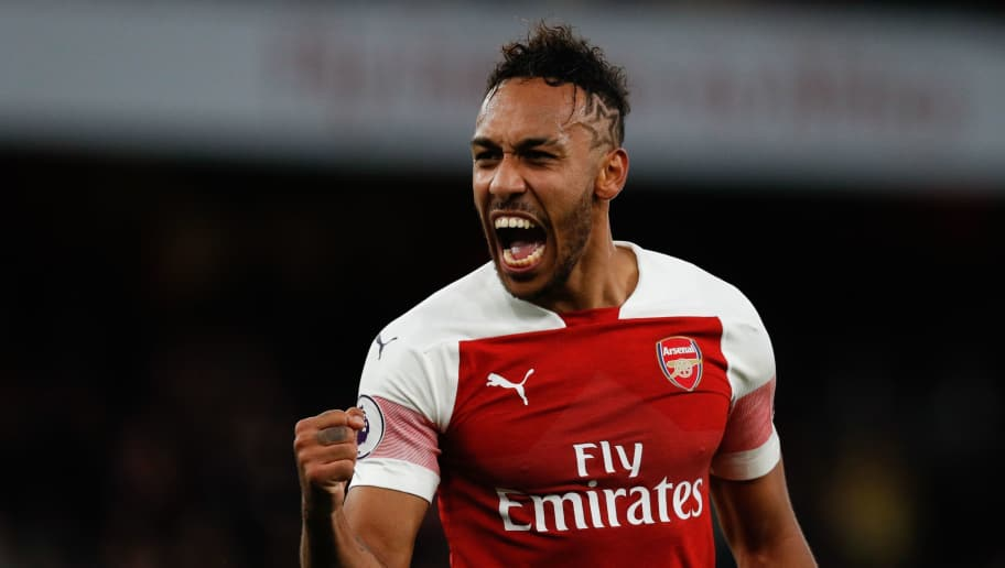Arsenal's Gabonese striker Pierre-Emerick Aubameyang celebrates on the pitch after the English Premier League football match between Arsenal and Tottenham Hotspur at the Emirates Stadium in London on December 2, 2018. - Arsenal won the game 4-2. (Photo by Adrian DENNIS / AFP) / RESTRICTED TO EDITORIAL USE. No use with unauthorized audio, video, data, fixture lists, club/league logos or 'live' services. Online in-match use limited to 120 images. An additional 40 images may be used in extra time. No video emulation. Social media in-match use limited to 120 images. An additional 40 images may be used in extra time. No use in betting publications, games or single club/league/player publications. /         (Photo credit should read ADRIAN DENNIS/AFP/Getty Images)