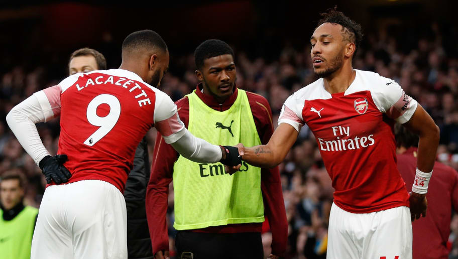 Arsenal's Gabonese striker Pierre-Emerick Aubameyang (R) celebrates with Arsenal's French striker Alexandre Lacazette (L) after scoring their second goal during the English Premier League football match between Arsenal and Tottenham Hotspur at the Emirates Stadium in London on December 2, 2018. (Photo by Adrian DENNIS / AFP) / RESTRICTED TO EDITORIAL USE. No use with unauthorized audio, video, data, fixture lists, club/league logos or 'live' services. Online in-match use limited to 120 images. An additional 40 images may be used in extra time. No video emulation. Social media in-match use limited to 120 images. An additional 40 images may be used in extra time. No use in betting publications, games or single club/league/player publications. /         (Photo credit should read ADRIAN DENNIS/AFP/Getty Images)