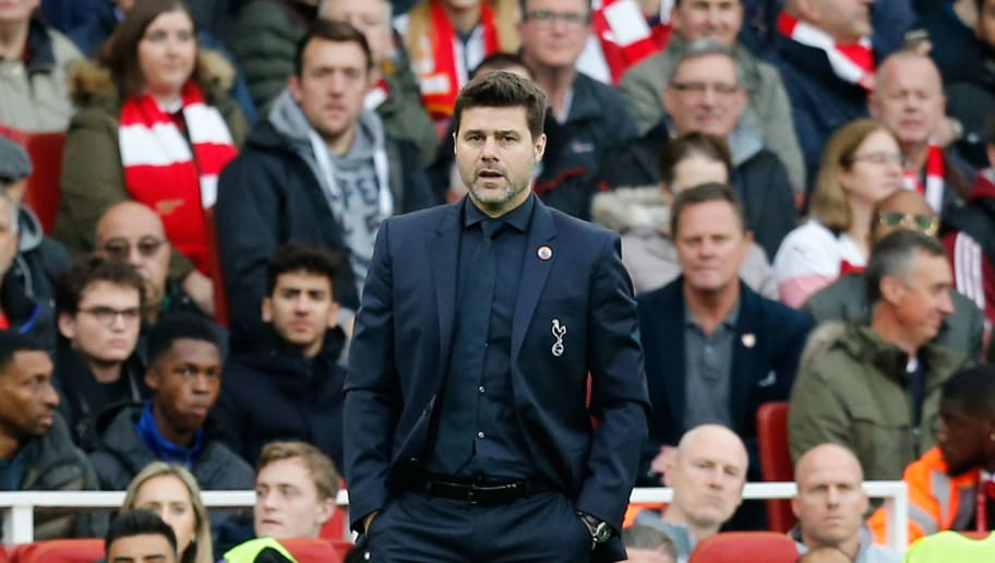 Tottenham Hotspur's Argentinian head coach Mauricio Pochettino looks on during the English Premier League football match between Arsenal and Tottenham Hotspur at the Emirates Stadium in London on December 2, 2018. (Photo by Ian KINGTON / IKIMAGES / AFP) / RESTRICTED TO EDITORIAL USE. No use with unauthorized audio, video, data, fixture lists, club/league logos or 'live' services. Online in-match use limited to 45 images, no video emulation. No use in betting, games or single club/league/player publications.        (Photo credit should read IAN KINGTON/AFP/Getty Images)