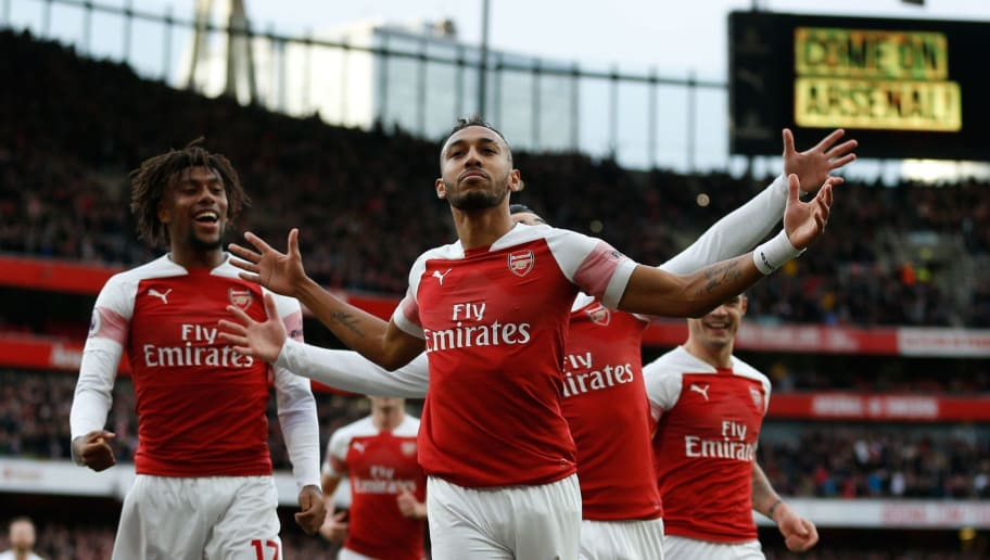 Arsenal's Gabonese striker Pierre-Emerick Aubameyang (C) celebrates after scoring the opening goal from the penalty spot during the English Premier League football match between Arsenal and Tottenham Hotspur at the Emirates Stadium in London on December 2, 2018. (Photo by Ian KINGTON / IKIMAGES / AFP) / RESTRICTED TO EDITORIAL USE. No use with unauthorized audio, video, data, fixture lists, club/league logos or 'live' services. Online in-match use limited to 45 images, no video emulation. No use in betting, games or single club/league/player publications.        (Photo credit should read IAN KINGTON/AFP/Getty Images)