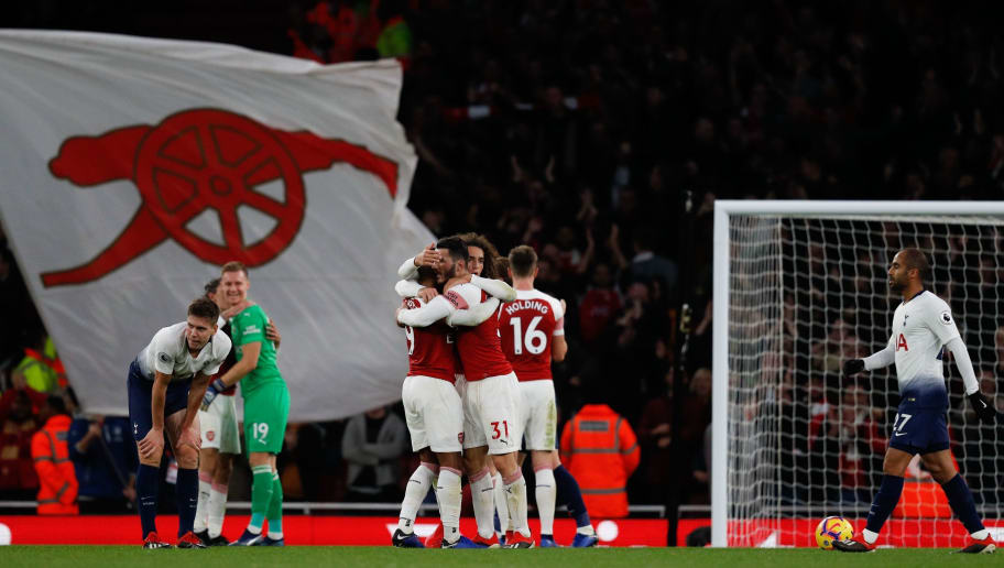 Arsenal's players celebrate on the pitch after the English Premier League football match between Arsenal and Tottenham Hotspur at the Emirates Stadium in London on December 2, 2018. - Arsenal won the game 4-2. (Photo by Adrian DENNIS / AFP) / RESTRICTED TO EDITORIAL USE. No use with unauthorized audio, video, data, fixture lists, club/league logos or 'live' services. Online in-match use limited to 120 images. An additional 40 images may be used in extra time. No video emulation. Social media in-match use limited to 120 images. An additional 40 images may be used in extra time. No use in betting publications, games or single club/league/player publications. /         (Photo credit should read ADRIAN DENNIS/AFP/Getty Images)