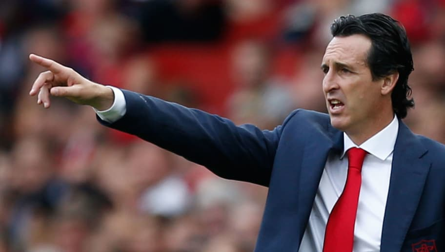 Arsenal's Spanish head coach Unai Emery gestures from the touchline during the English Premier League football match between Arsenal and West Ham United at the Emirates Stadium in London on August 25, 2018. (Photo by Ian KINGTON / AFP) / RESTRICTED TO EDITORIAL USE. No use with unauthorized audio, video, data, fixture lists, club/league logos or 'live' services. Online in-match use limited to 120 images. An additional 40 images may be used in extra time. No video emulation. Social media in-match use limited to 120 images. An additional 40 images may be used in extra time. No use in betting publications, games or single club/league/player publications. /         (Photo credit should read IAN KINGTON/AFP/Getty Images)