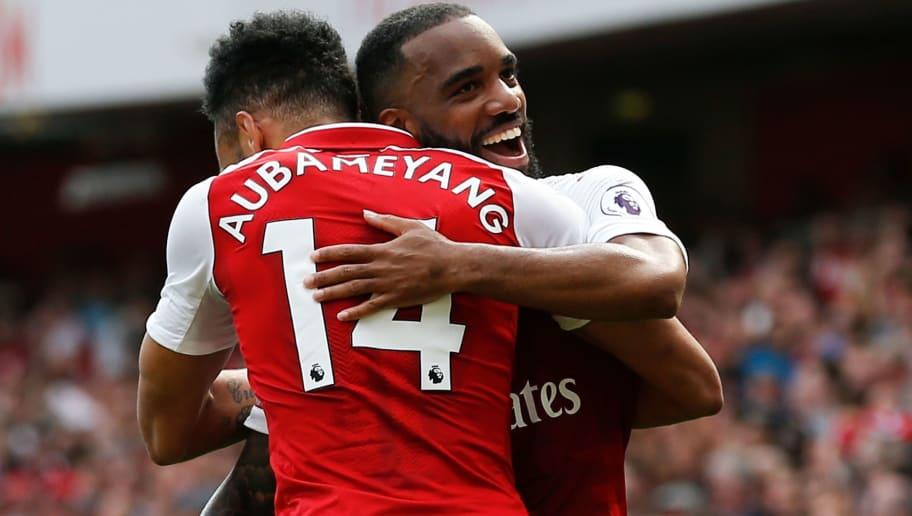 Arsenal's French striker Alexandre Lacazette (R) celebrates scoring their fourth goal with Arsenal's Gabonese striker Pierre-Emerick Aubameyang (L) during the English Premier League football match between Arsenal and West Ham United at the Emirates Stadium in London on April 22, 2018. (Photo by Ian KINGTON / AFP) / RESTRICTED TO EDITORIAL USE. No use with unauthorized audio, video, data, fixture lists, club/league logos or 'live' services. Online in-match use limited to 75 images, no video emulation. No use in betting, games or single club/league/player publications. /         (Photo credit should read IAN KINGTON/AFP/Getty Images)