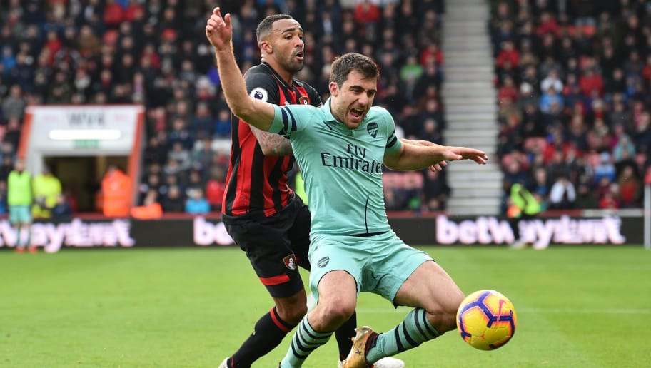 Bournemouth's English striker Callum Wilson (L) tangles with Arsenal's Greek defender Sokratis Papastathopoulos (R) during the English Premier League football match between Bournemouth and Arsenal at the Vitality Stadium in Bournemouth, southern England on November 25, 2018. (Photo by Glyn KIRK / AFP) / RESTRICTED TO EDITORIAL USE. No use with unauthorized audio, video, data, fixture lists, club/league logos or 'live' services. Online in-match use limited to 120 images. An additional 40 images may be used in extra time. No video emulation. Social media in-match use limited to 120 images. An additional 40 images may be used in extra time. No use in betting publications, games or single club/league/player publications. /         (Photo credit should read GLYN KIRK/AFP/Getty Images)