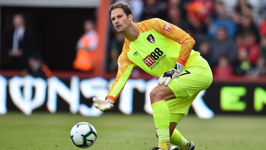 Bournemouth's Bosnian-Herzegovinian goalkeeper Asmir Begovic rolls out the ball during the English Premier League football match between Bournemouth and Everton at the Vitality Stadium in Bournemouth, southern England on August 25, 2018. (Photo by Glyn KIRK / AFP) / RESTRICTED TO EDITORIAL USE. No use with unauthorized audio, video, data, fixture lists, club/league logos or 'live' services. Online in-match use limited to 120 images. An additional 40 images may be used in extra time. No video emulation. Social media in-match use limited to 120 images. An additional 40 images may be used in extra time. No use in betting publications, games or single club/league/player publications. /         (Photo credit should read GLYN KIRK/AFP/Getty Images)