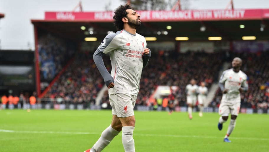 Liverpool's Egyptian midfielder Mohamed Salah celebrates scoring his and Liverpool's second goal during the English Premier League football match between Bournemouth and Liverpool at the Vitality Stadium in Bournemouth, southern England on December 8, 2018. (Photo by Glyn KIRK / AFP) / RESTRICTED TO EDITORIAL USE. No use with unauthorized audio, video, data, fixture lists, club/league logos or 'live' services. Online in-match use limited to 120 images. An additional 40 images may be used in extra time. No video emulation. Social media in-match use limited to 120 images. An additional 40 images may be used in extra time. No use in betting publications, games or single club/league/player publications. /         (Photo credit should read GLYN KIRK/AFP/Getty Images)