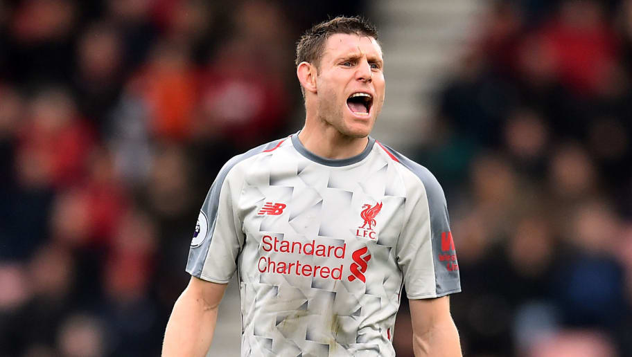 Liverpool's English midfielder James Milner gestures during the English Premier League football match between Bournemouth and Liverpool at the Vitality Stadium in Bournemouth, southern England on December 8, 2018. - Liverpool's English midfielder James Milner is making his 500th Premier League appearance. (Photo by Glyn KIRK / AFP) / RESTRICTED TO EDITORIAL USE. No use with unauthorized audio, video, data, fixture lists, club/league logos or 'live' services. Online in-match use limited to 120 images. An additional 40 images may be used in extra time. No video emulation. Social media in-match use limited to 120 images. An additional 40 images may be used in extra time. No use in betting publications, games or single club/league/player publications. /         (Photo credit should read GLYN KIRK/AFP/Getty Images)