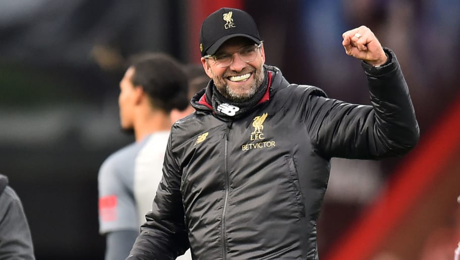 Liverpool's German manager Jurgen Klopp celebrates on the pitch after the English Premier League football match between Bournemouth and Liverpool at the Vitality Stadium in Bournemouth, southern England on December 8, 2018. - Liverpool won the game 4-0. (Photo by Glyn KIRK / AFP) / RESTRICTED TO EDITORIAL USE. No use with unauthorized audio, video, data, fixture lists, club/league logos or 'live' services. Online in-match use limited to 120 images. An additional 40 images may be used in extra time. No video emulation. Social media in-match use limited to 120 images. An additional 40 images may be used in extra time. No use in betting publications, games or single club/league/player publications. /         (Photo credit should read GLYN KIRK/AFP/Getty Images)