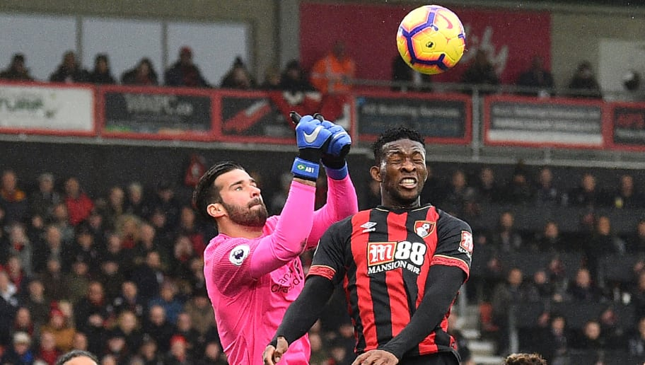 Liverpool's Brazilian goalkeeper Alisson Becker (L) comes out to punch under pressure from Bournemouth's Colombian midfielder Jefferson Lerma during the English Premier League football match between Bournemouth and Liverpool at the Vitality Stadium in Bournemouth, southern England on December 8, 2018. (Photo by Glyn KIRK / AFP) / RESTRICTED TO EDITORIAL USE. No use with unauthorized audio, video, data, fixture lists, club/league logos or 'live' services. Online in-match use limited to 120 images. An additional 40 images may be used in extra time. No video emulation. Social media in-match use limited to 120 images. An additional 40 images may be used in extra time. No use in betting publications, games or single club/league/player publications. /         (Photo credit should read GLYN KIRK/AFP/Getty Images)