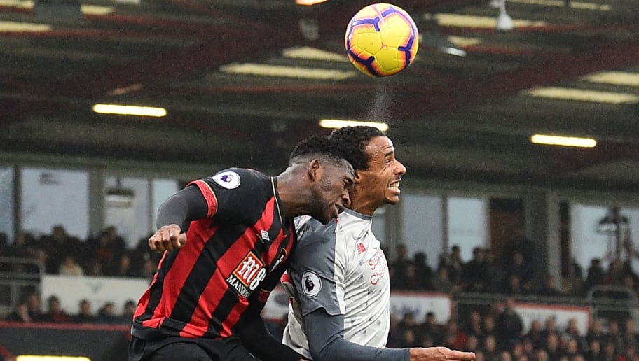 Liverpool's German-born Cameroonian defender Joel Matip (R) and Bournemouth's Colombian midfielder Jefferson Lerma (L) compete for the ball during the English Premier League football match between Bournemouth and Liverpool at the Vitality Stadium in Bournemouth, southern England on December 8, 2018. (Photo by Glyn KIRK / AFP) / RESTRICTED TO EDITORIAL USE. No use with unauthorized audio, video, data, fixture lists, club/league logos or 'live' services. Online in-match use limited to 120 images. An additional 40 images may be used in extra time. No video emulation. Social media in-match use limited to 120 images. An additional 40 images may be used in extra time. No use in betting publications, games or single club/league/player publications. /         (Photo credit should read GLYN KIRK/AFP/Getty Images)