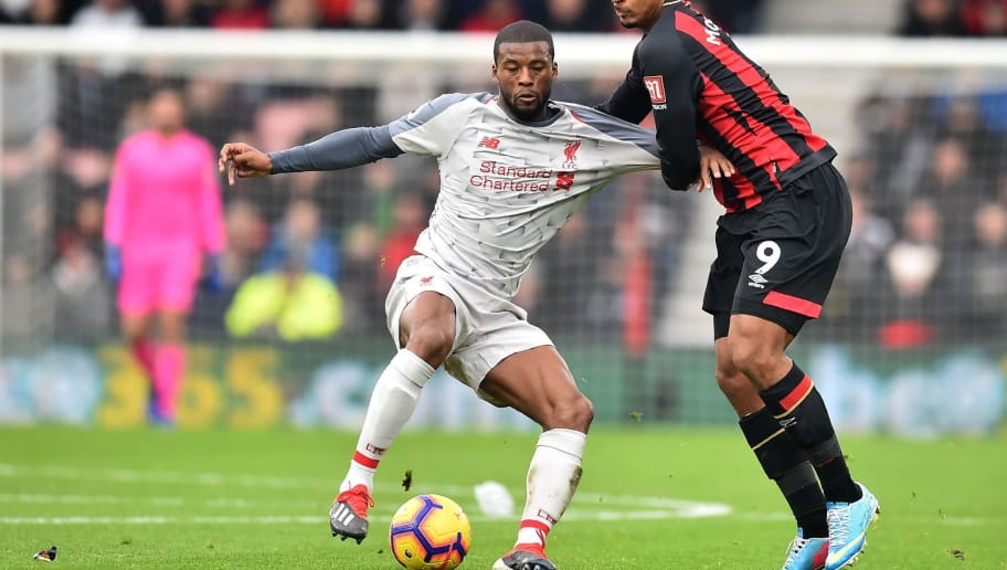 Liverpool's Dutch midfielder Georginio Wijnaldum vies with Bournemouth's French striker Lys Mousset (R) during the English Premier League football match between Bournemouth and Liverpool at the Vitality Stadium in Bournemouth, southern England on December 8, 2018. (Photo by Glyn KIRK / AFP) / RESTRICTED TO EDITORIAL USE. No use with unauthorized audio, video, data, fixture lists, club/league logos or 'live' services. Online in-match use limited to 120 images. An additional 40 images may be used in extra time. No video emulation. Social media in-match use limited to 120 images. An additional 40 images may be used in extra time. No use in betting publications, games or single club/league/player publications. /         (Photo credit should read GLYN KIRK/AFP/Getty Images)