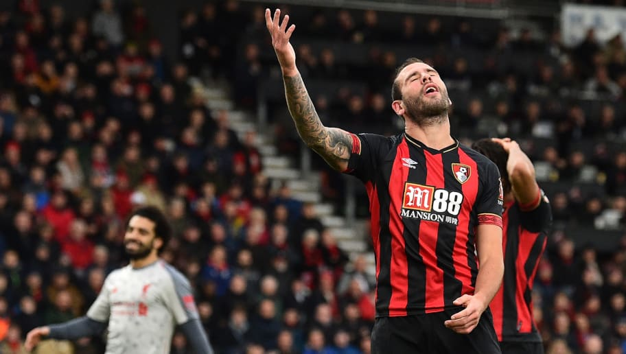 Bournemouth's English defender Steve Cook (R) reacts after he deflects a cross into his own net during the English Premier League football match between Bournemouth and Liverpool at the Vitality Stadium in Bournemouth, southern England on December 8, 2018. (Photo by Glyn KIRK / AFP) / RESTRICTED TO EDITORIAL USE. No use with unauthorized audio, video, data, fixture lists, club/league logos or 'live' services. Online in-match use limited to 120 images. An additional 40 images may be used in extra time. No video emulation. Social media in-match use limited to 120 images. An additional 40 images may be used in extra time. No use in betting publications, games or single club/league/player publications. /         (Photo credit should read GLYN KIRK/AFP/Getty Images)