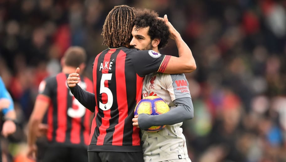 Liverpool's Egyptian midfielder Mohamed Salah (R) holding the match-ball for scoring a hat-trick is embraced by Bournemouth's Dutch defender Nathan Ake on the pitch after the English Premier League football match between Bournemouth and Liverpool at the Vitality Stadium in Bournemouth, southern England on December 8, 2018. - Liverpool won the game 4-0. (Photo by Glyn KIRK / AFP) / RESTRICTED TO EDITORIAL USE. No use with unauthorized audio, video, data, fixture lists, club/league logos or 'live' services. Online in-match use limited to 120 images. An additional 40 images may be used in extra time. No video emulation. Social media in-match use limited to 120 images. An additional 40 images may be used in extra time. No use in betting publications, games or single club/league/player publications. /         (Photo credit should read GLYN KIRK/AFP/Getty Images)
