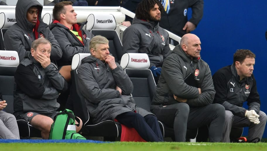 Arsenal's kit manager Vic Akers (L), Arsenal's French manager Arsene Wenger (2nd L), Arsenal's assistant manager Steve Bould (2nd R) and Head of medical services Colin Lewin (R) react on in their seats as Arsenal trail, during the English Premier League football match between Brighton and Hove Albion and Arsenal at the American Express Community Stadium in Brighton, southern England on March 4, 2018. Brighton won the game 2-1. / AFP PHOTO / Glyn KIRK / RESTRICTED TO EDITORIAL USE. No use with unauthorized audio, video, data, fixture lists, club/league logos or 'live' services. Online in-match use limited to 75 images, no video emulation. No use in betting, games or single club/league/player publications.  /         (Photo credit should read GLYN KIRK/AFP/Getty Images)