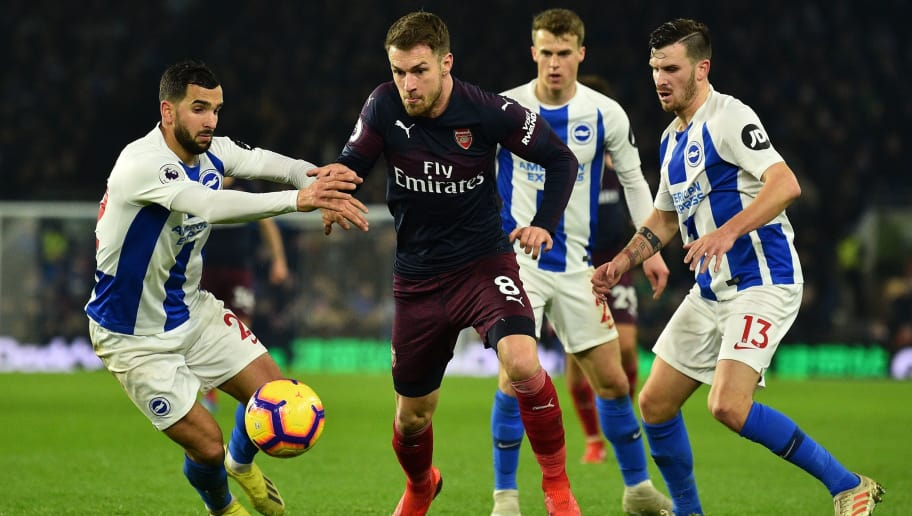 Arsenal's Welsh midfielder Aaron Ramsey reacts as the ball goes out of play during the English Premier League football match between Brighton and Hove Albion and Arsenal at the American Express Community Stadium in Brighton, southern England on December 26, 2018. (Photo by Glyn KIRK / AFP) / RESTRICTED TO EDITORIAL USE. No use with unauthorized audio, video, data, fixture lists, club/league logos or 'live' services. Online in-match use limited to 120 images. An additional 40 images may be used in extra time. No video emulation. Social media in-match use limited to 120 images. An additional 40 images may be used in extra time. No use in betting publications, games or single club/league/player publications. /         (Photo credit should read GLYN KIRK/AFP/Getty Images)