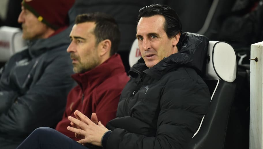 Arsenal's Spanish head coach Unai Emery takes his seat for the English Premier League football match between Brighton and Hove Albion and Arsenal at the American Express Community Stadium in Brighton, southern England on December 26, 2018. (Photo by Glyn KIRK / AFP) / RESTRICTED TO EDITORIAL USE. No use with unauthorized audio, video, data, fixture lists, club/league logos or 'live' services. Online in-match use limited to 120 images. An additional 40 images may be used in extra time. No video emulation. Social media in-match use limited to 120 images. An additional 40 images may be used in extra time. No use in betting publications, games or single club/league/player publications. /         (Photo credit should read GLYN KIRK/AFP/Getty Images)